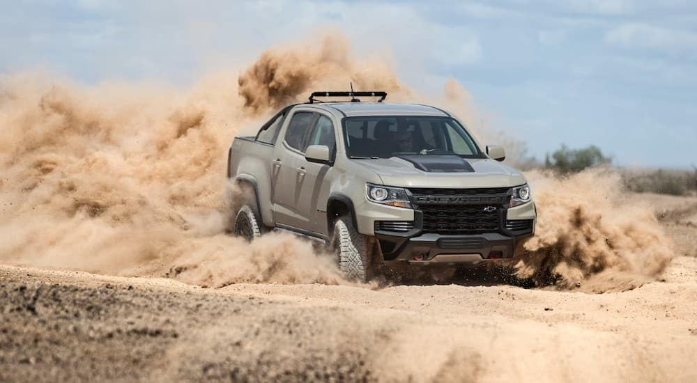 A tan 2021 Chevy Colorado ZR2 is kicking up sand while off-roading near Cincinnati, OH.