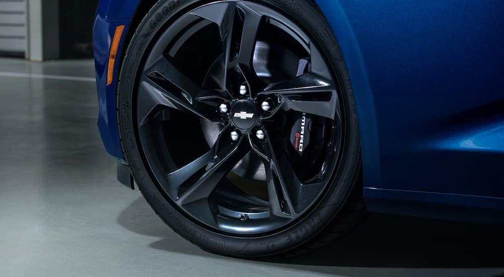 The wheel setup on a blue 2020 Chevy Camaro is shown in closeup.