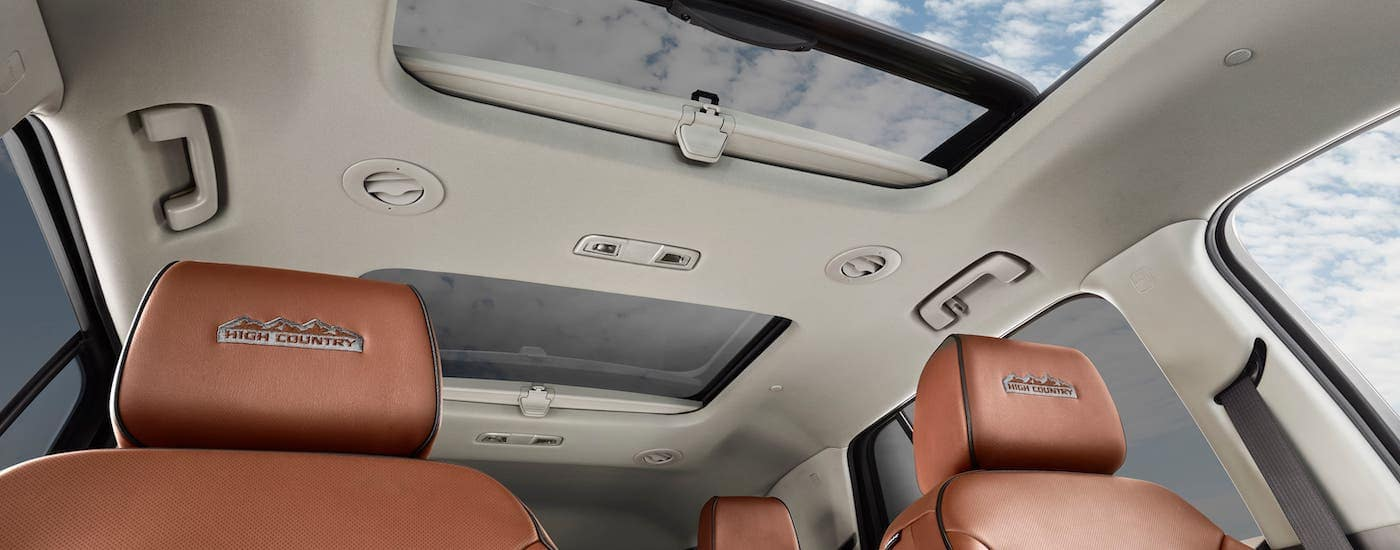 The leather seats and sunroof in a 2020 Chevy Traverse are shown from a low angle.