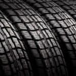 A closeup shows several tires.