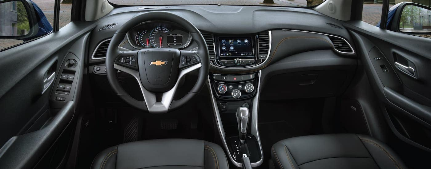 The black interior of a 2020 Chevy Trax is shown.