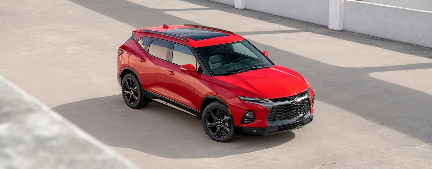 A red 2020 Chevy Blazer RS is shown from a high angle while parked in a parking garage.