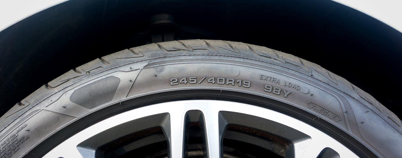 A closeup shows the number code on a tire.