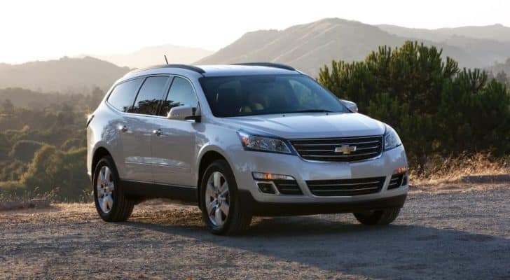 A silver 2016 used Chevy Traverse is parked on a mountain top.