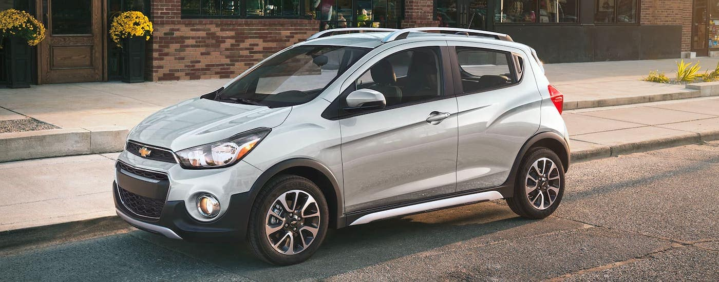 A silver 2021 Chevy Spark is parked on a street in Cincinnati, OH.