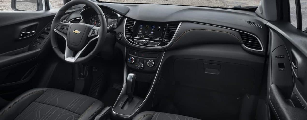 The black interior of a 2021 Chevy Trax is shown.