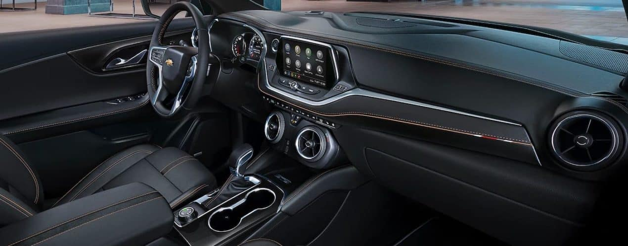 The black interior with orange accent stitching is shown in a 2021 Chevy Blazer.
