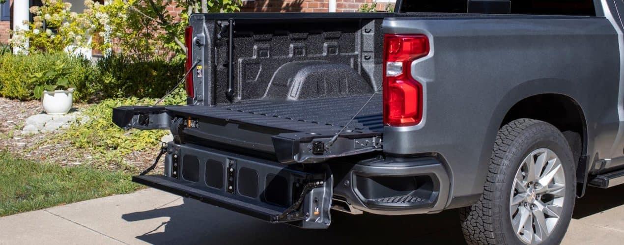 A closeup shows the open Multi-Flex tailgate on a gray 2021 Chevy Silverado 1500 High Country.