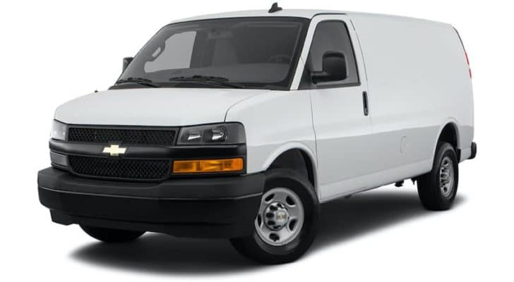 A white 2021 Chevy Express Cargo Van is angled left.