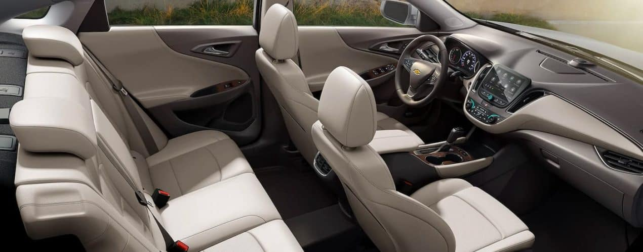 The cream interior is shown from a high angle on a 2021 Chevy Malibu.
