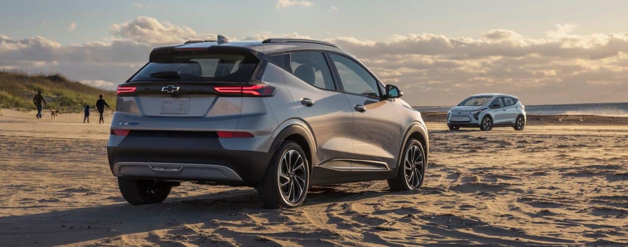 A silver 2022 Chevy Bolt EUV is shown from the rear while parked on a beach.