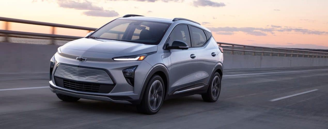 A silver 2022 Chevy Bolt EUV is driving on a highway.