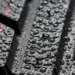 A close up shows the wet tread on a set of good rain tires.