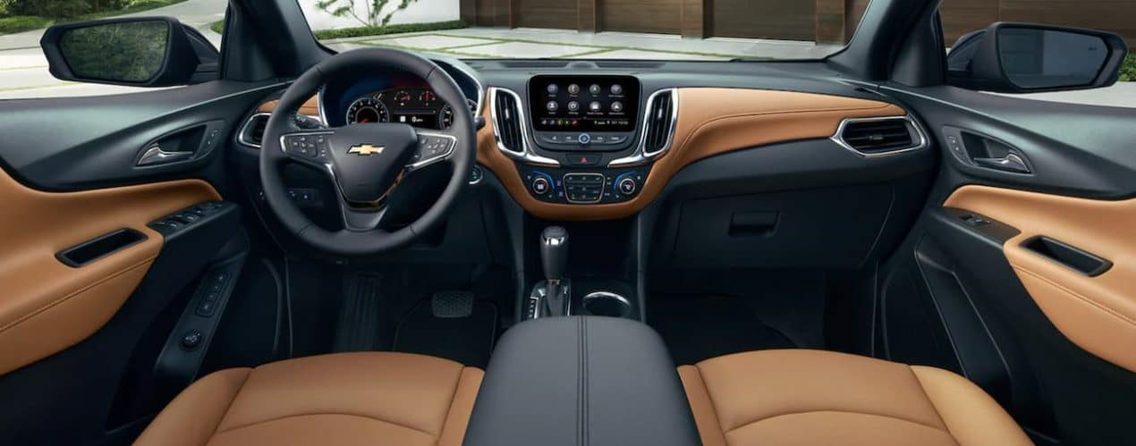 The black and brown interior of a 2021 Chevy Equinox is shown.