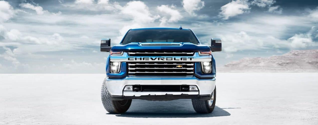 A blue 2021 Chevy Silverado 3500 HD is shown from the front.