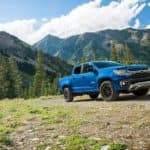 A blue 2022 Chevy Colorado is shown parked in a field after looking at new cars in stock.