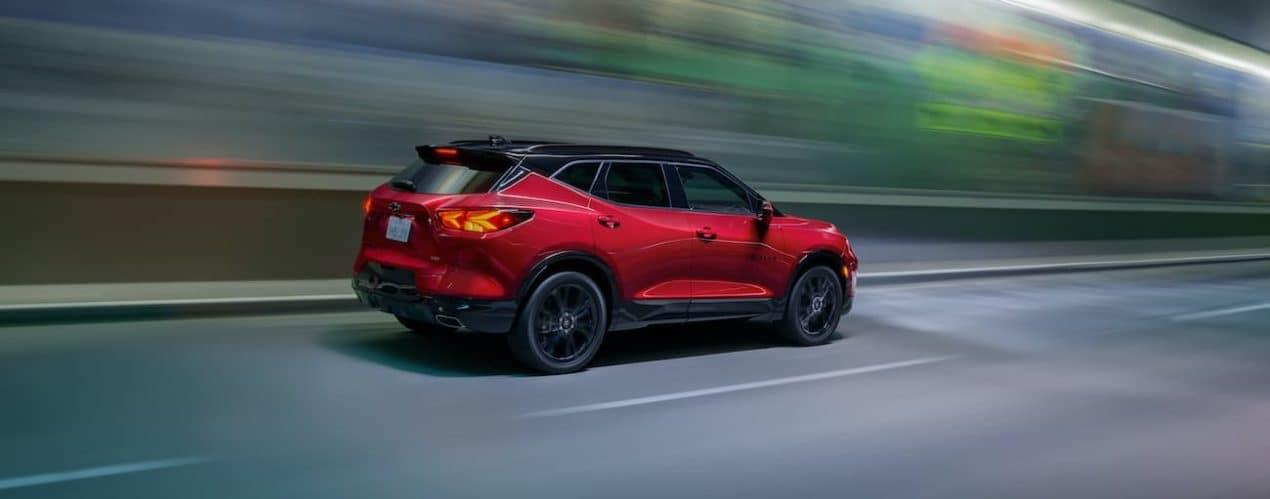 A red 2022 Chevy Blazer RS is shown driving through a tunnel.