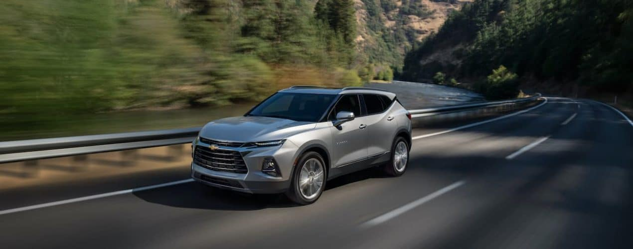 A silver 2022 Chevy Blazer is shown driving on a highway.