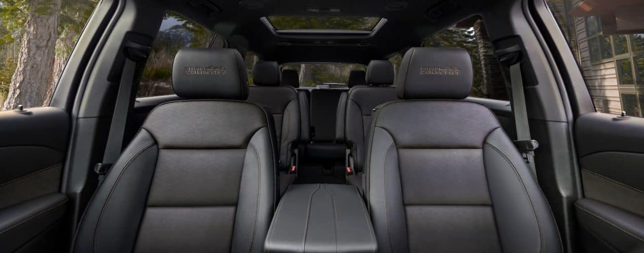 The black interior of a 2022 Chevy Traverse shows three rows of seating.