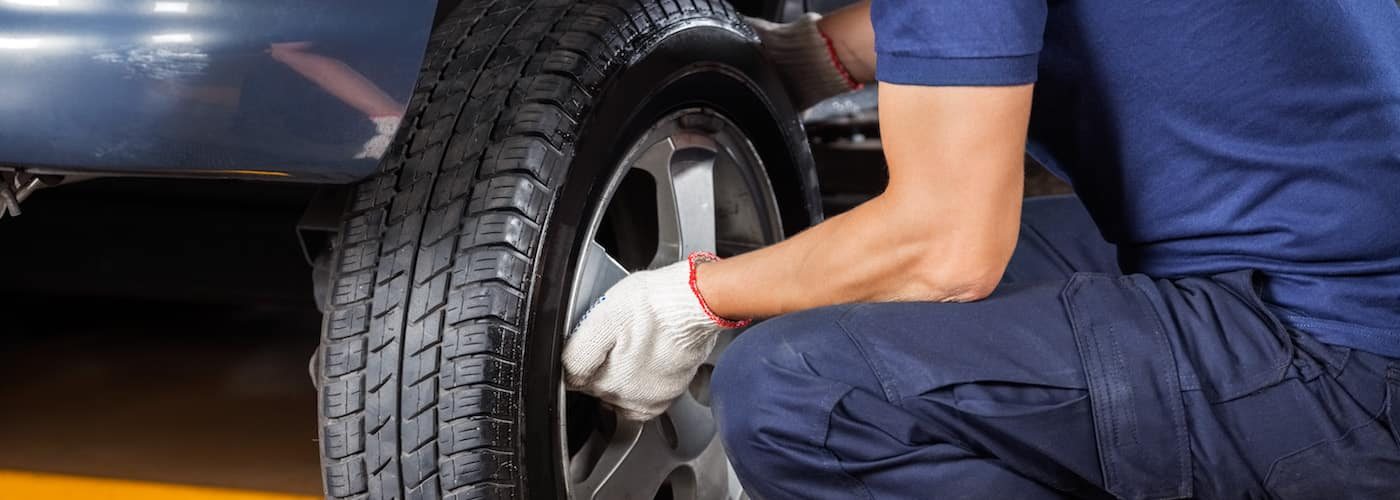 Mechanic Changing Tire in Shop