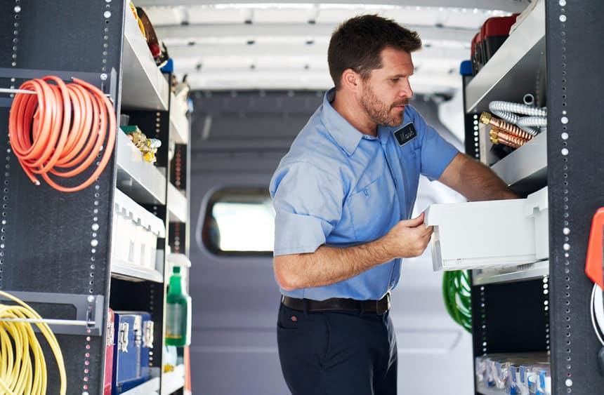 Workman in the back of Metris van