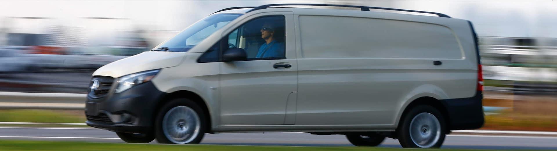 Metris Van Driving Down the Road