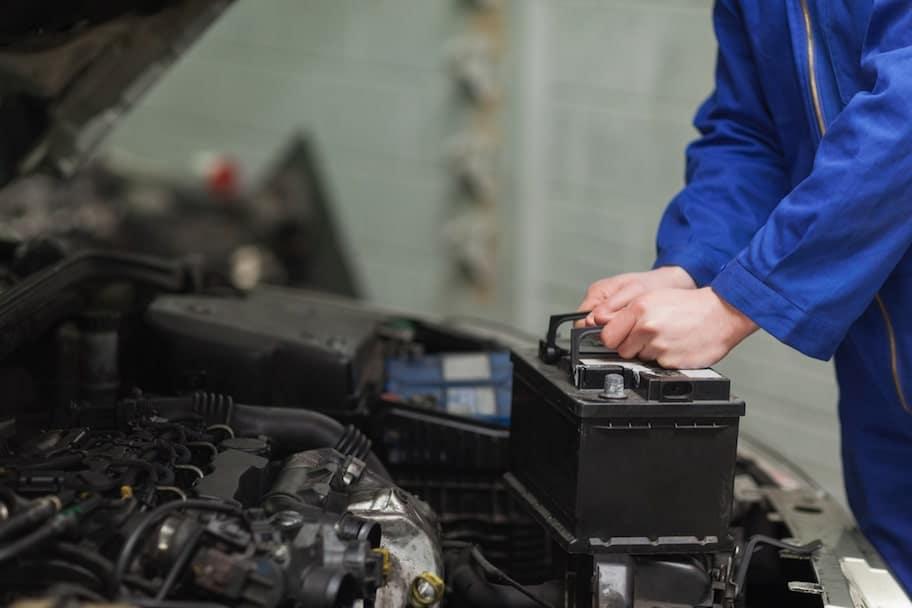 Mazda Certified Technician Replacing Car Battery