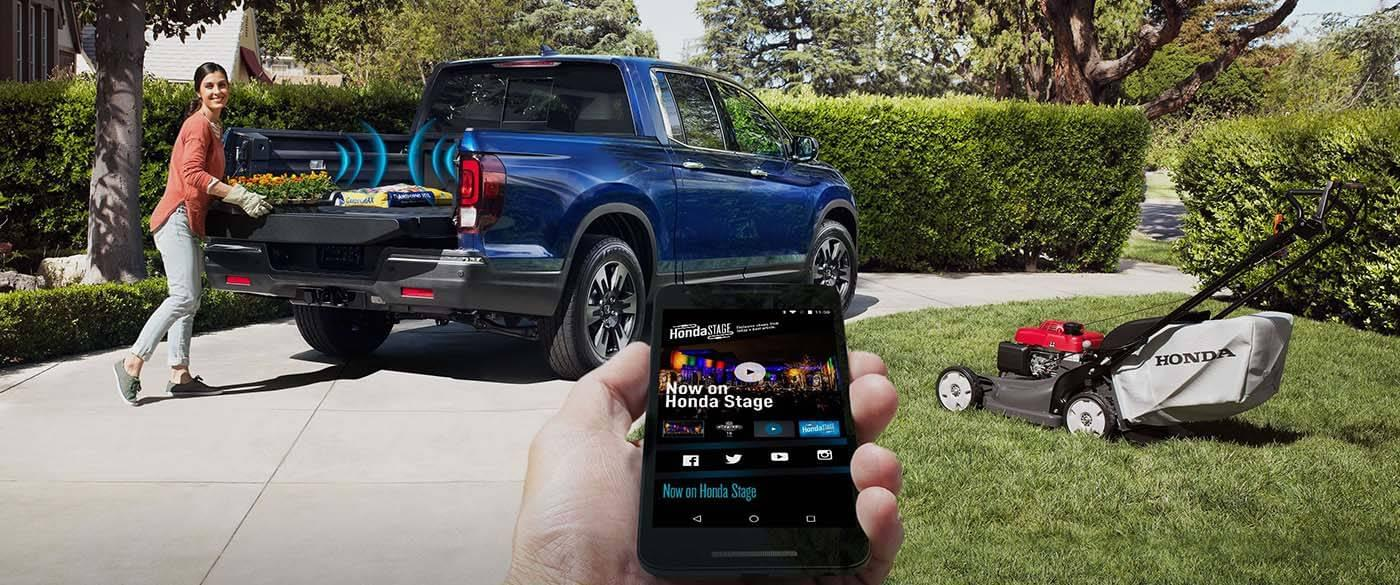 can be found in the bed of the Ridgeline: an available truck-bed audio ...