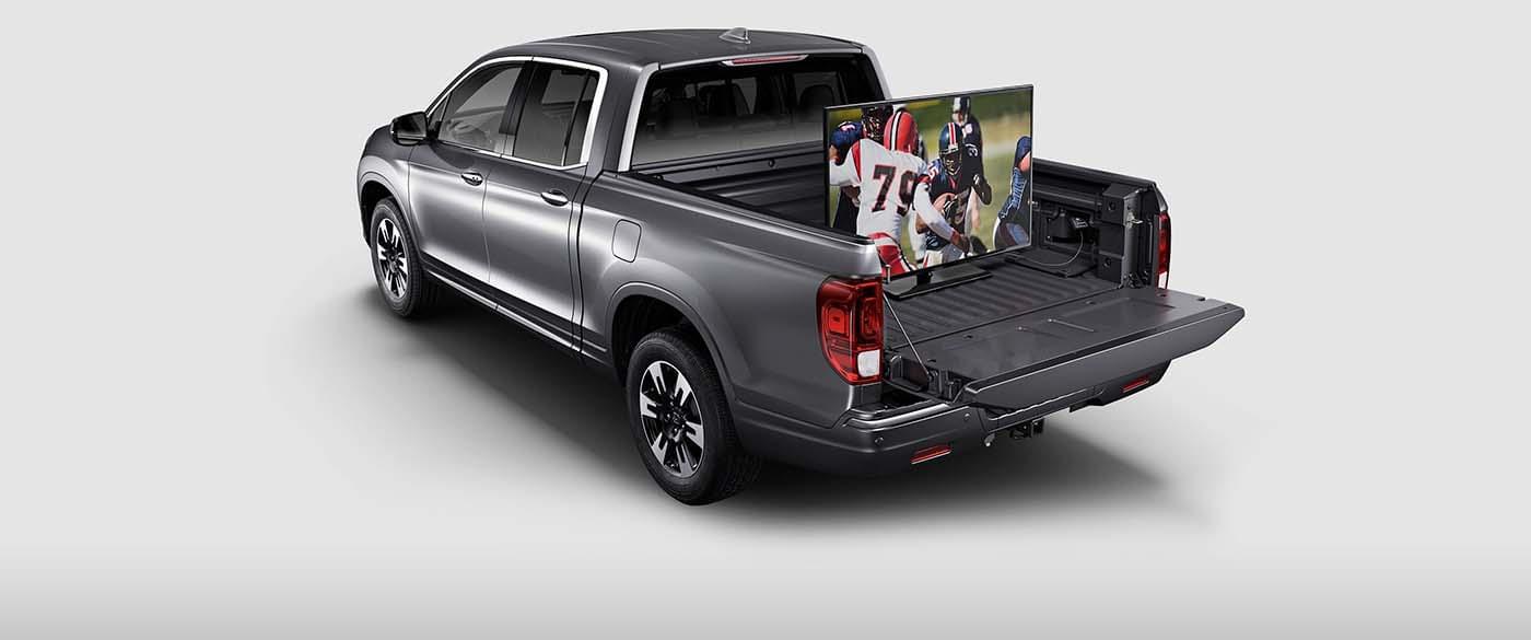 2017 Honda Ridgeline TV plugged in bed of truck
