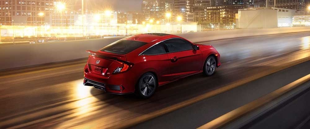 2017 Honda Civic Si Coupe driving down a highway
