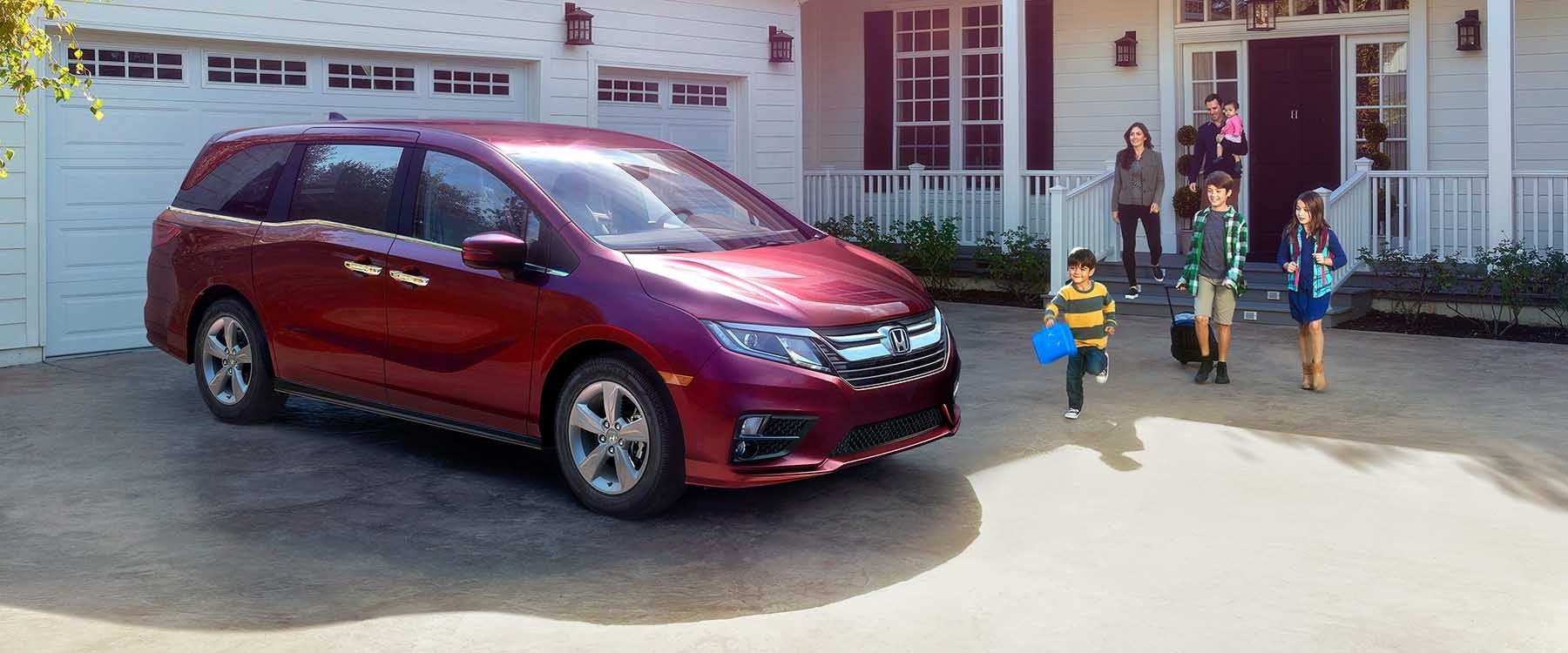 2019 Honda Odyssey Parked in Driveway of Home