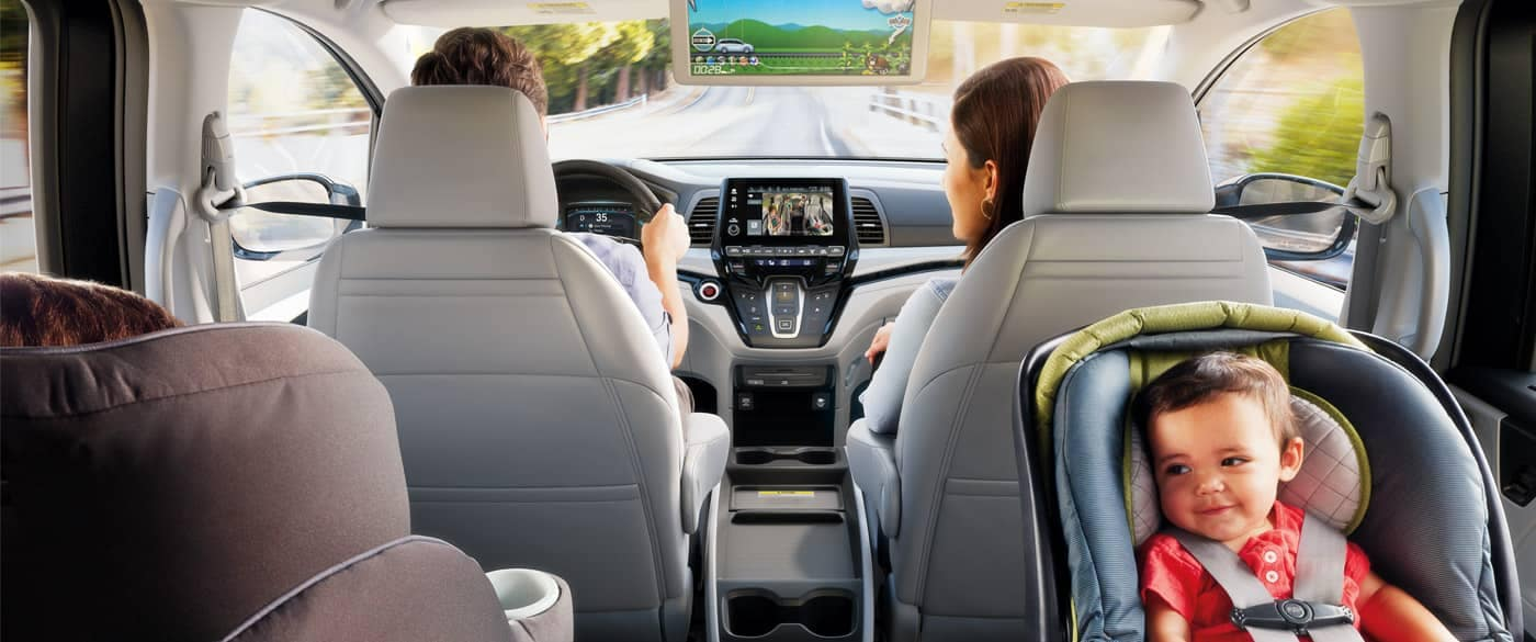 Interior view from the backseat of a family driving a 2018 Honda Odyssey