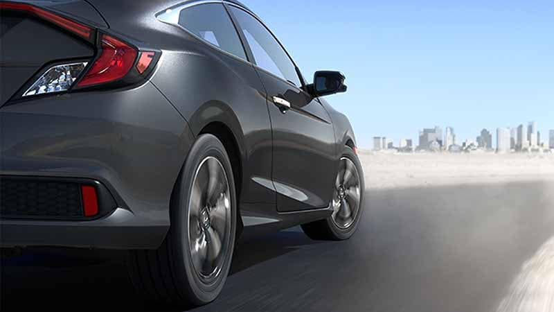 2018 Honda Civic Coupe driving fast closeup of tires