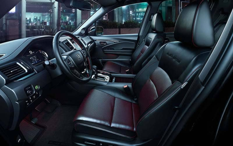 2019 Honda Ridgeline Black Edition Front Seating and Dashboard with Red Ambient Lighting