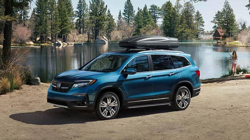 2019 Honda Pilot Parked At Lake With Family Camping