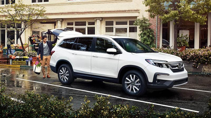 2019 Honda Pilot Parked in parking lot with man loading groceries