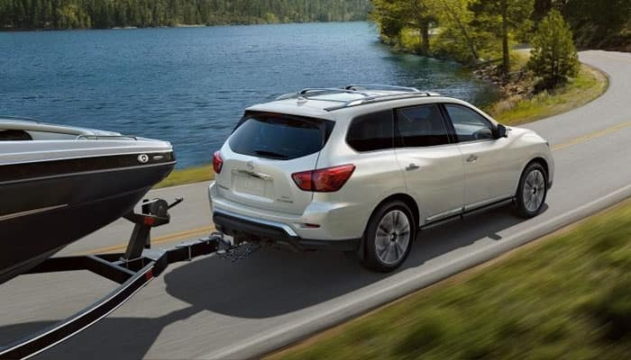 2019 Nissan Pathfinder Towing Boat on Road