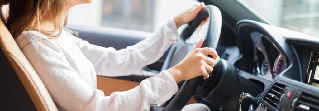 woman takes test drive west palm beach fl
