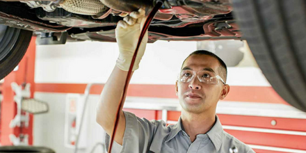 Toyota Employee Changing Oil