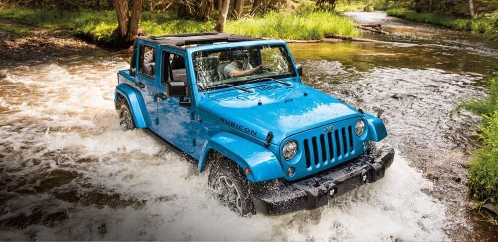 2018 Jeep Wrangler JK traversing a raging river