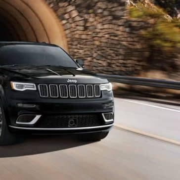 2019 Jeep Grand Cherokee speeding through a tunnel