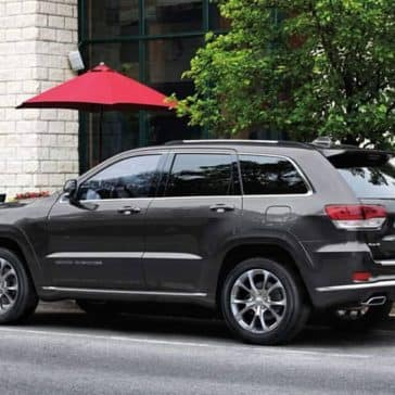 2019 Jeep Grand Cherokee parked in front of cosmopolitan cafe