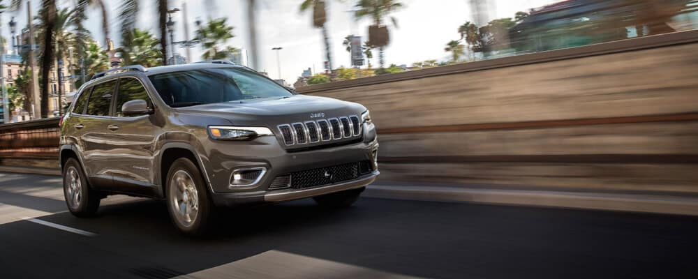 2021 Jeep Cherokee driving down a california highway