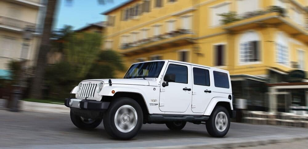 2018 Jeep Wrangler JK in front of apartments