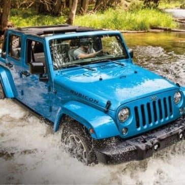2018 Jeep Wrangler JK traversing raging river
