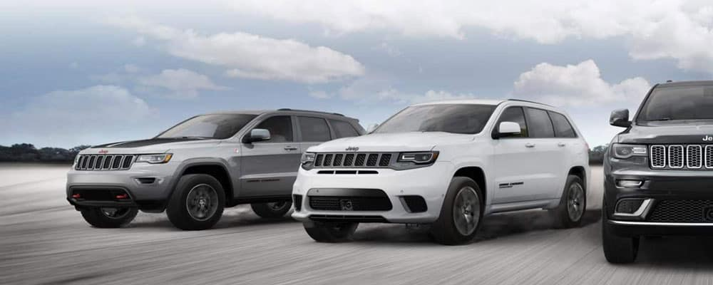Three 2019 Jeep Grand Cherokee Driving