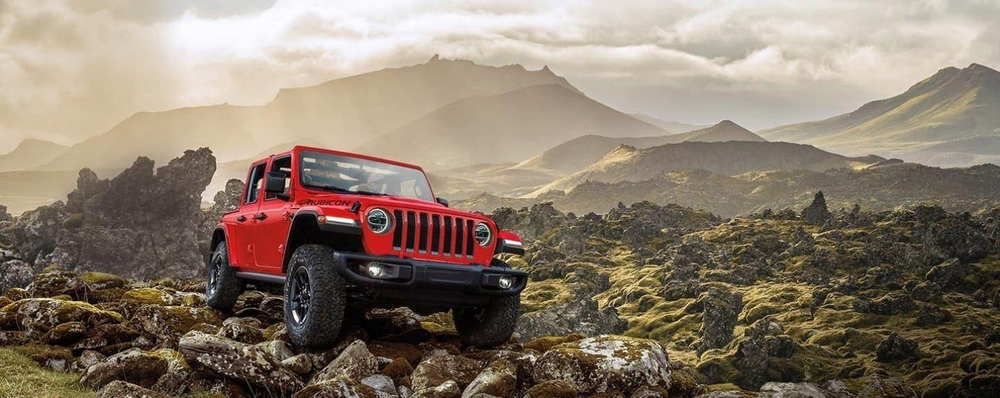 2020 Jeep Wrangler driving on rocky path