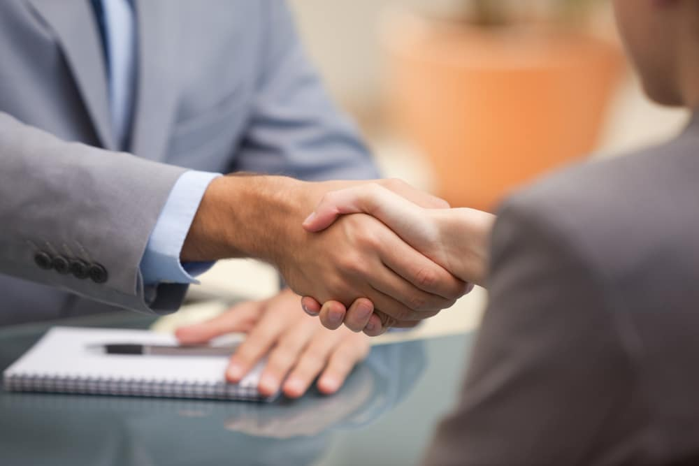 Shaking Hands With a Car Salesperson