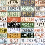 Collage of American license plates on a wall