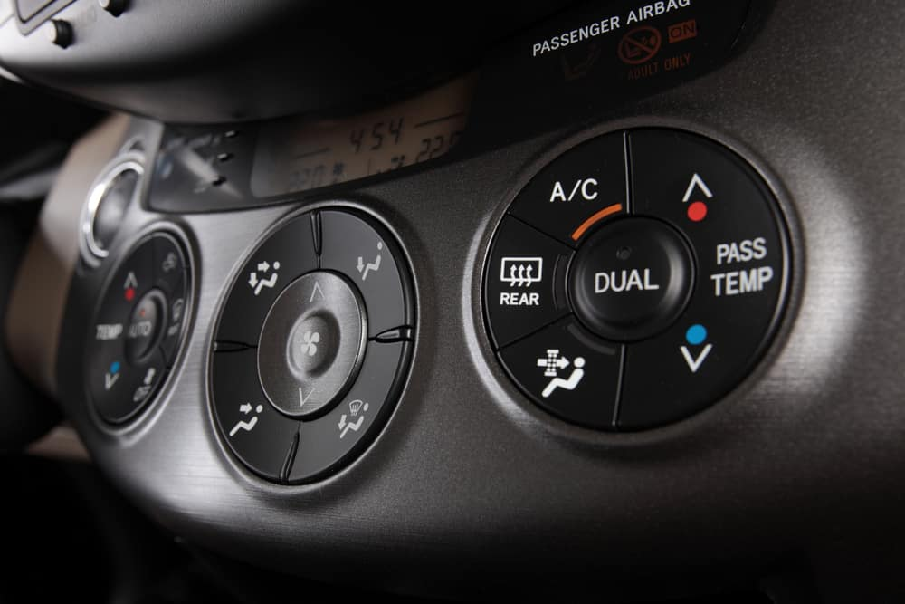 Air conditioning control panel on vehicle dashboard